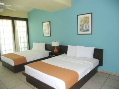 Superior Room w/ 2 Queen beds Beachfront + Kitchen